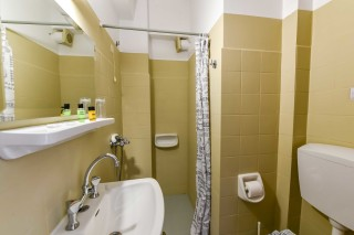 economy double room ionis hotel bathroom