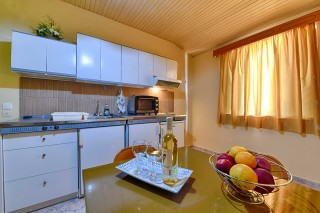 kitchen apartment ionis hotel fruits